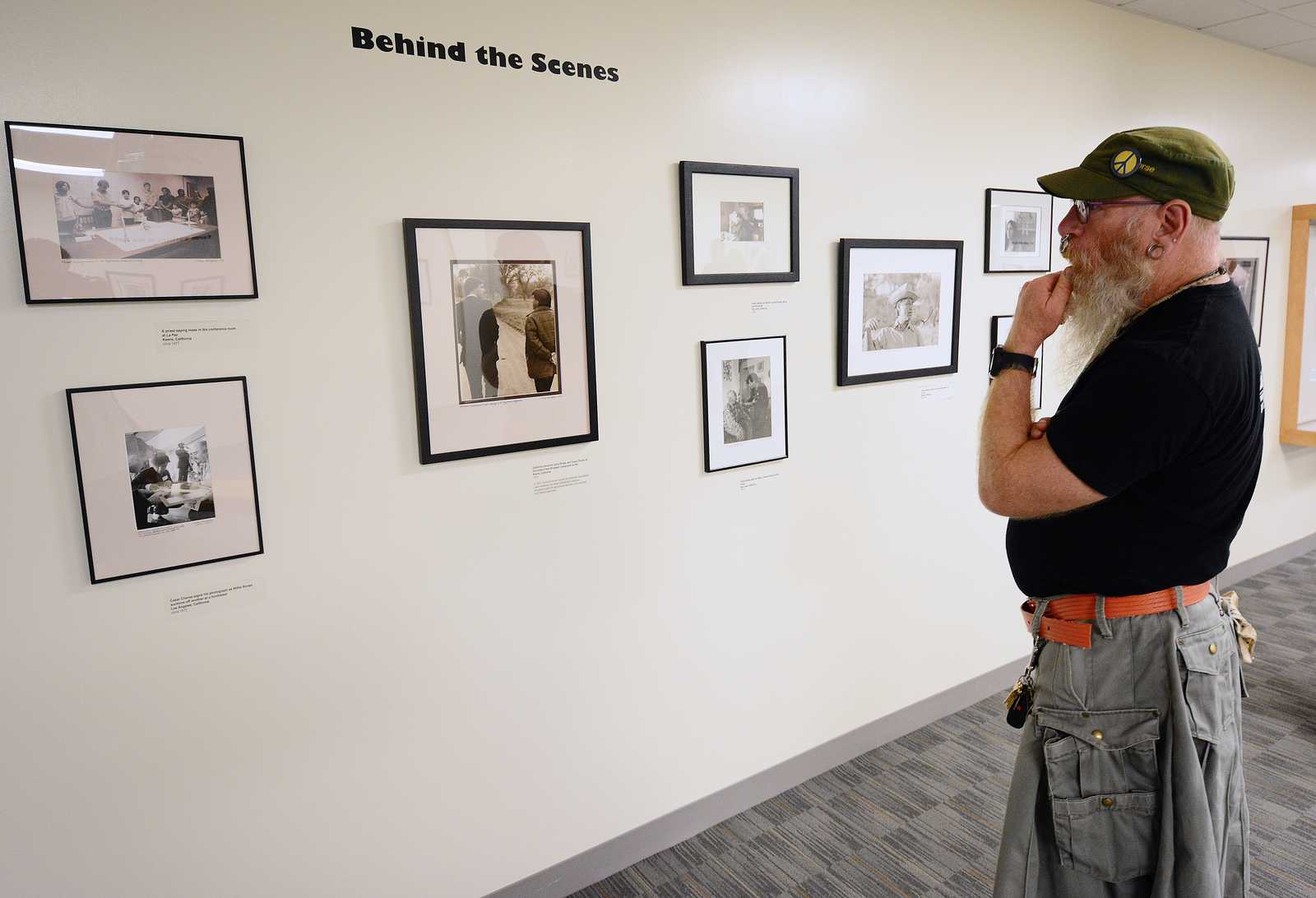 Woody Miller, graduate student, observes photographs in the Marching Through History with Cesar Chavez and the Farm Workers exhibit at J. Paul Leonard Library on Monday, Sept. 16, 2013. Photo By Philip Houston / Xpress