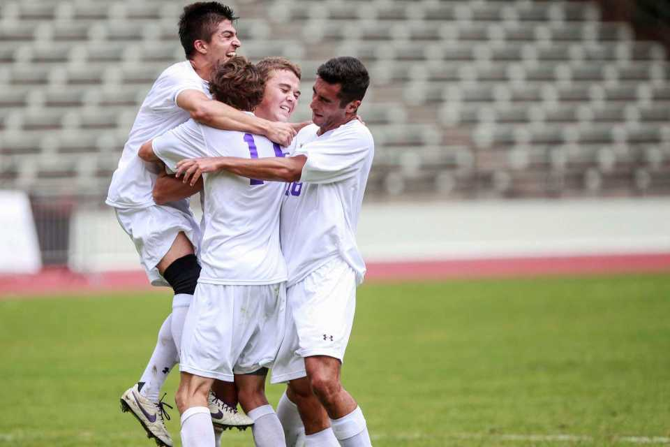 Matias Rodriguez(5), Hayden Roberts(15), Cole Dimond(7) and Davis Brady(16) celebrate after a goal by Andrew Ogilvy(20) against Cal State Los Angeles at Cox Stadium, Sept. 20, 2013. The Gators won the game, 1-0. Photo by Mike Hendrickson / Xpress