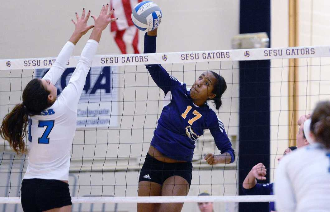 SF State's Kaileen Mejia (17) spikes the ball in front of Alexandra Torline (17) during a match against 22nd ranked Cal State San Bernardino Coyotes on Saturday, Sept. 21, 2013 at SF State. The Gators lost 3-2. Photo By Philip Houston / Xpress