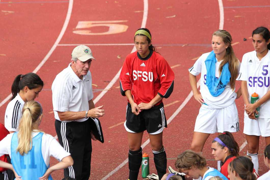 Head Women's Soccer Coach Jack Hyde talks with players during half-time at a game against Cal State Los Angeles at the SF State Cox Stadium on Sept. 20, 2013. Photo Ryan Leibrich / Xpress