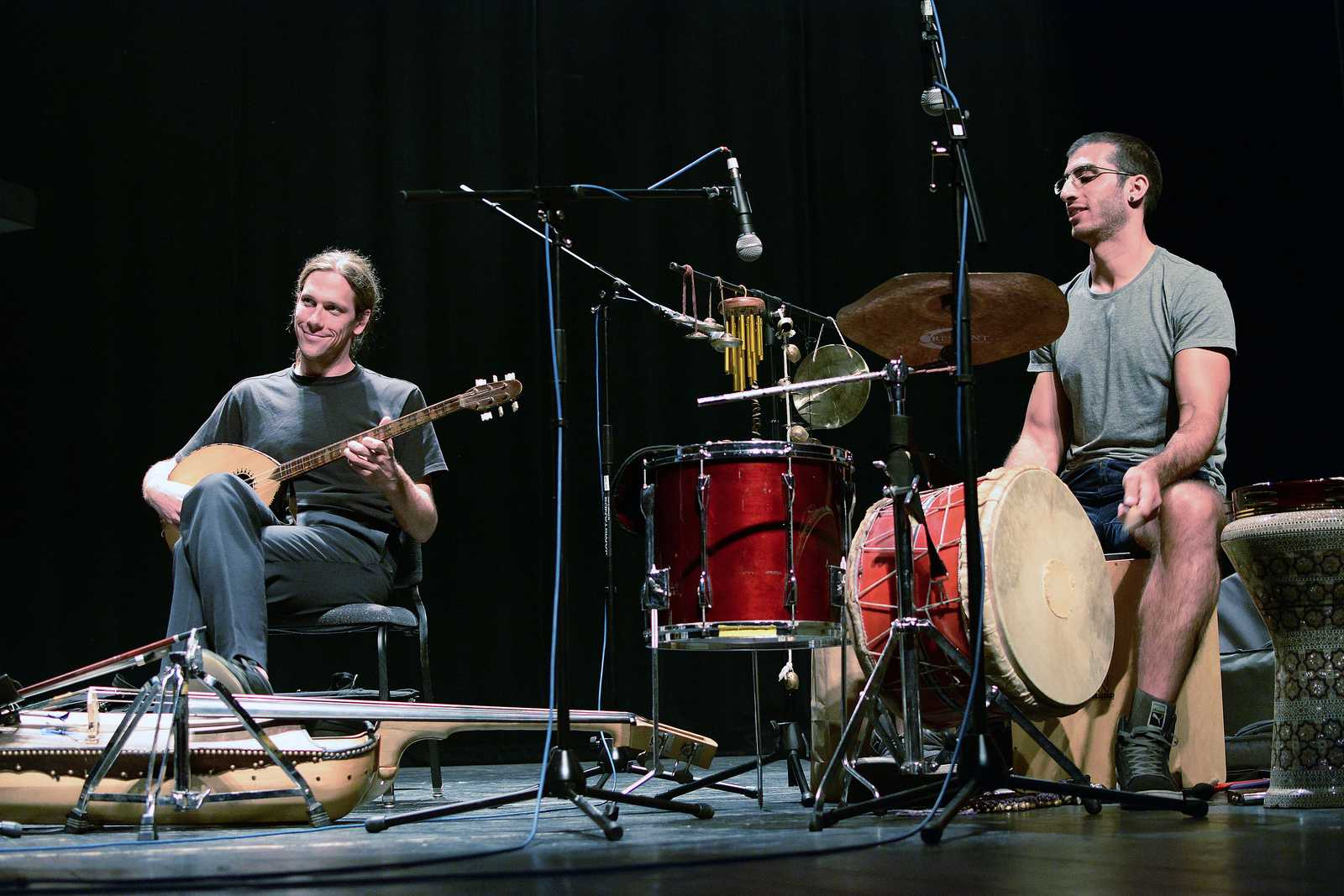 Miles Jay (left) plays the buzuq as Tareq Rantisi (right) beats a drum during an Arabic music seminar in McKenna Theater on Saturday, Sept. 28, 2013. The seminar was part of Room for Hope, a festival celebrating Palestinian culture. Photo by Philip Houston / Xpress