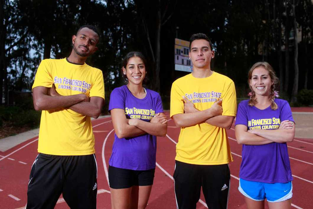 (Left to right) Bruk Assefa, Zuleima Bernal, Benji Preciado and Paxton Cota pose for a portrait in Cox Stadium at SF State on Oct. 21 before a practice run. They're the top ranked runners from SF State going in to the CCAA Championships on Oct. 26. Photo by Mike Hendrickson / Xpress