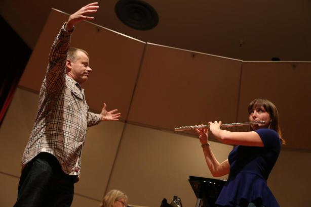 "Michael Hasel, flute player for the Berlin Philharmonic Wind Quintet, instructs SF State student and flute player Abigail Green to breath deeper, connect with the audience, and have better posture during a Masterclass session in Knuth Hall in the Creative Arts building Friday Feb. 28. ""You have all the tools in your toolbox, you just have to use them,"" he said. Photo by Rachel Aston / Xpress"