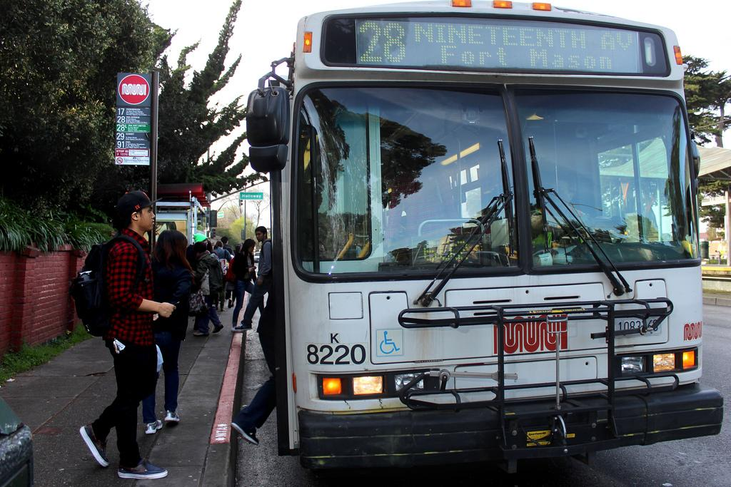 Sophomore Kinesology major Rodney Torres boards a 28 bus at the bus stop at the top of campus on 19th Avenue heading toward Fort Mason Monday, March 10. Photo by Tony Santos / Xpress
