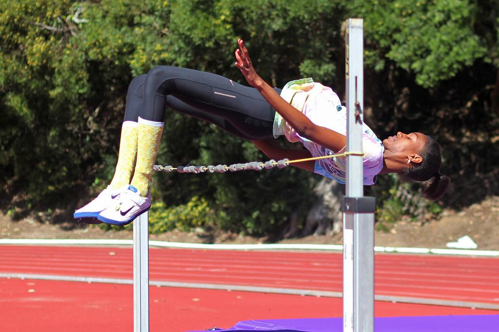 Tiana Wills practices the high jump on the track at Cox Stadium Monday, March 17. Photo by Jenny Sokolova / Xpress