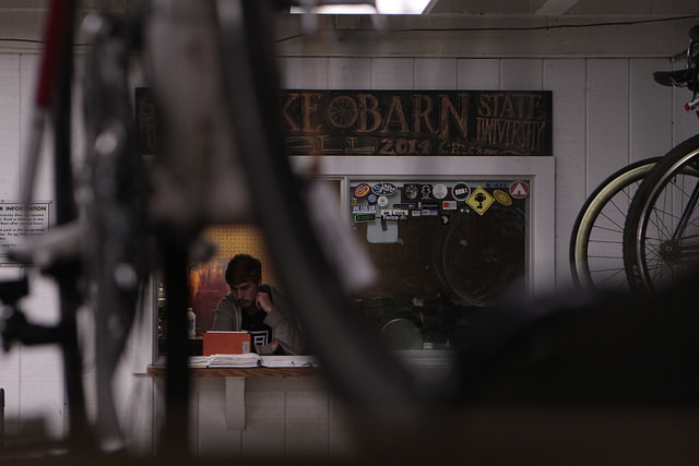 Tim Stone, third year, works the front desk at the Bike Barn at San Francisco State University in San Francisco, Calif. on Tuesday September 2, 2014. Stone has been working at the bike barn for a year now. Daniel Porter / Xpress.