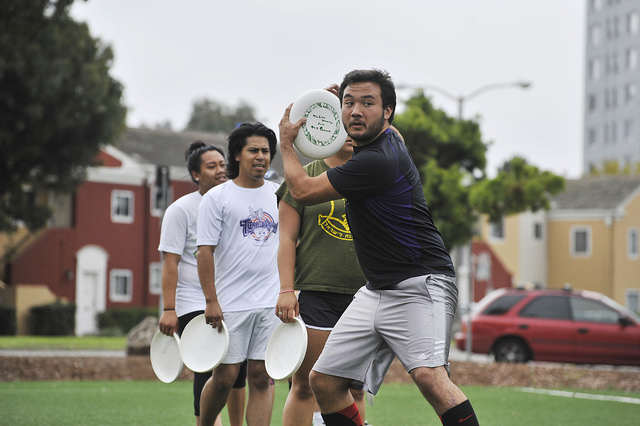 Jacob Hsieh, 22, prepares to throw a disc during drills at Ultimate Frisbee Club practice on the West Campus Green on Friday, Sept. 12, 2014. Sara Gobets / Xpress.