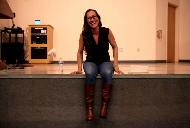 Hollie Hardy laughs during a Q&A with the Writers on Writing class in the Humanities Building auditorium. The poet gave tips on being a writer in the Bay Area to many of the creative writing undergraduates and MFA students Monday, Sept. 15, 2014. Lorisa Salvatin / Xpress.