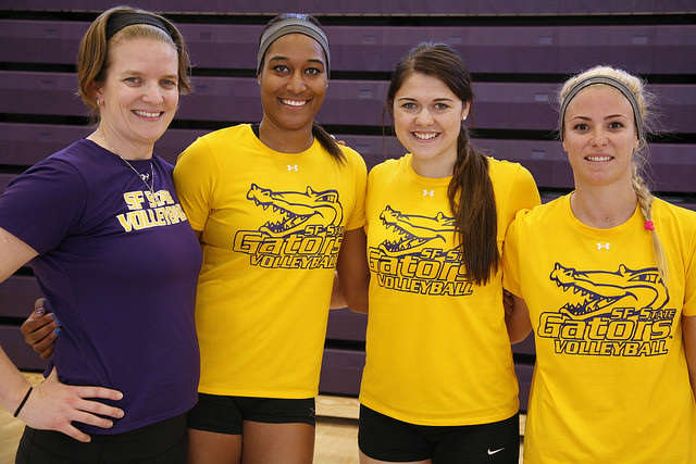 Coach Jill Muhe (left) and graduating seniors (left to right) Jazmine Williams, Melissa Horton and Jacquie Brice. Martin Bustamante / Xpress.