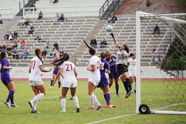 Cal State East Bay Pioneer goal keeper Briana Scholtens, #1, punches the ball out of danger after a SF State Gator attempt on goal at Cox Stadium on Sunday, Sept. 28, 2014. Sara Gobets / Xpress.