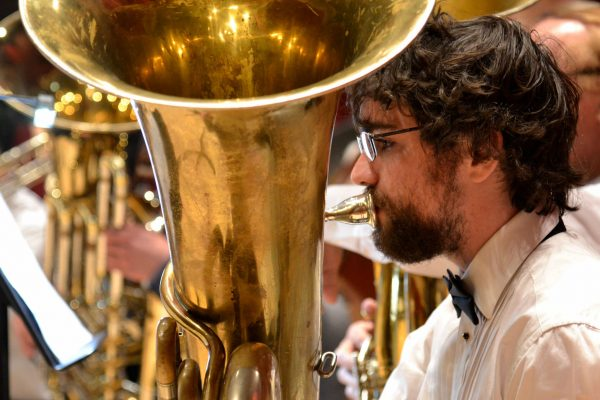 "Connor Swartwood plays the tuba during a rehearsal with the SF State Wind Ensemble in preparation for ""A Honeymoon in Paris"" Thursday, Oct. 9, 2014. Annastashia Goolsby / Xpress."