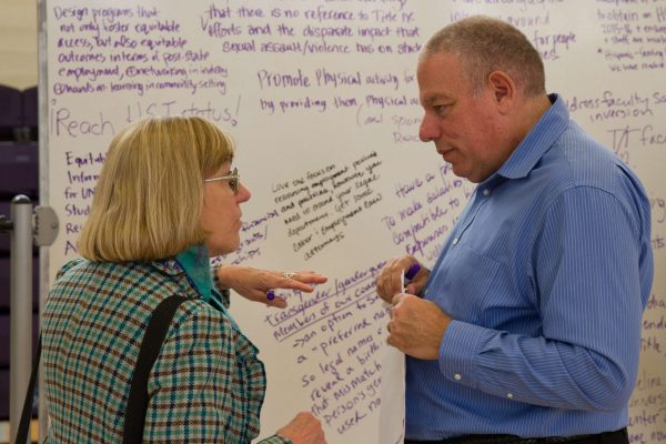 Deborah C. Masters, University Librarian, and John Elia, Associate Dean of Health and Social Sciences, discuss the topics expressed at the Equity table during the Academic Senate's Strategic Plan meeting in the SF State Gymnasium Tuesday, Oct. 21, 2014. Eric Gorman/Xpress.