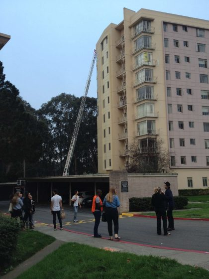 Firefighters extinguish an apartment fire on the sixth floor of 235 Buckingham Way in UPN Monday, Oct. 13, 2014. Nashelly Chavez / Xpress.