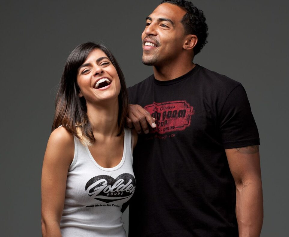man and woman wearing golden goods tee