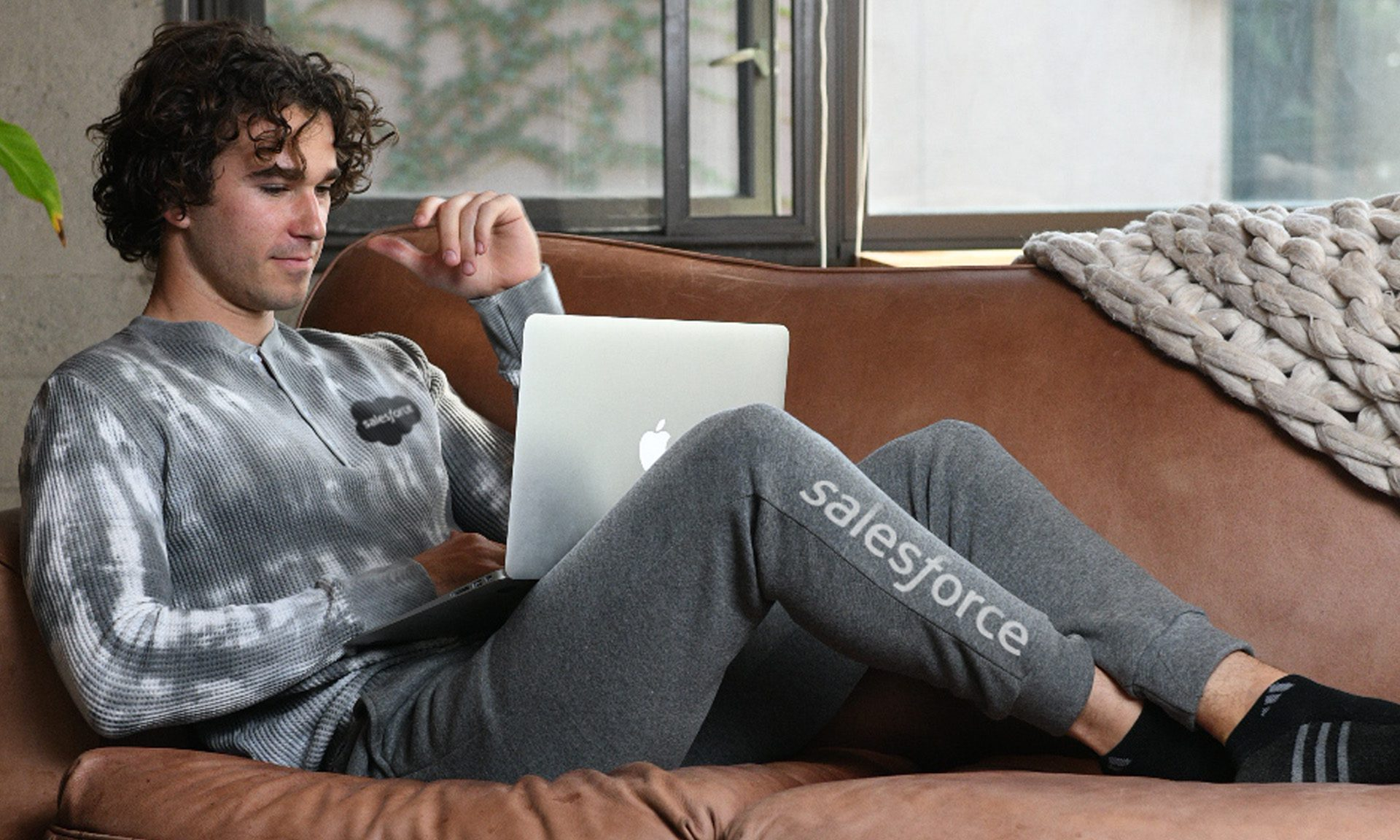 man on laptop with thermal henley and jogger
