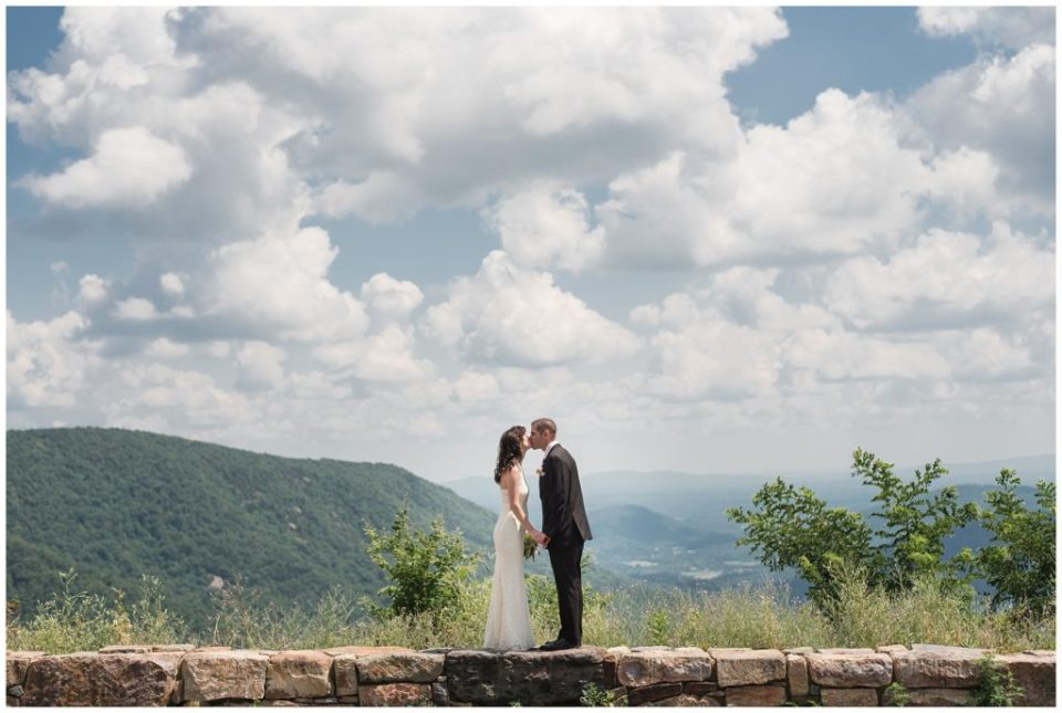 bride and groom on mountain top