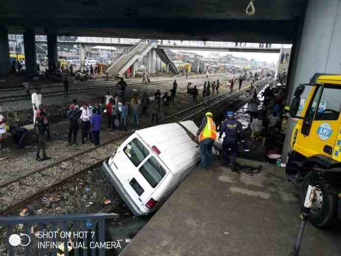Moment Train Collides With Bus In Lagos