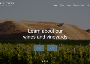 Screenshot: Shell Creek Vineyards home slider with photo of vineyard and buttons to wine and vines pages