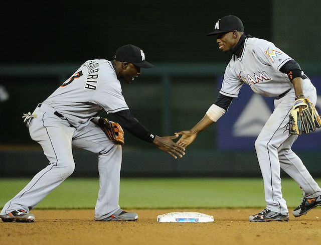 Marlins coach Perry Hill works positioning and basics with infield