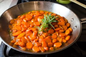 rosemary carrots cooking on the stovetop
