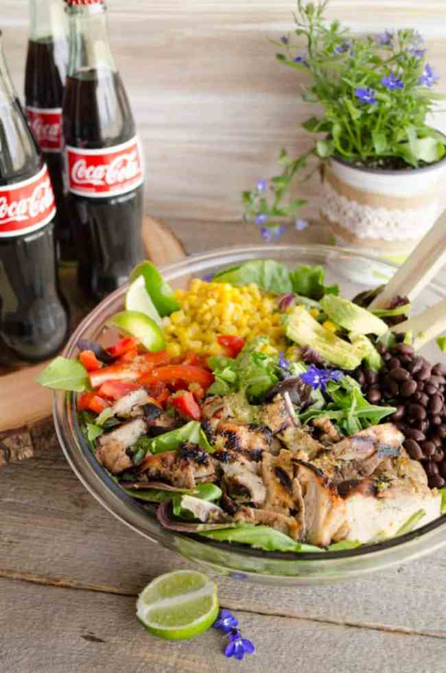 Southwestern Grilled Chicken Salad in a large bowl next to bottles of Coca-Cola - The Goldilocks Kitchen