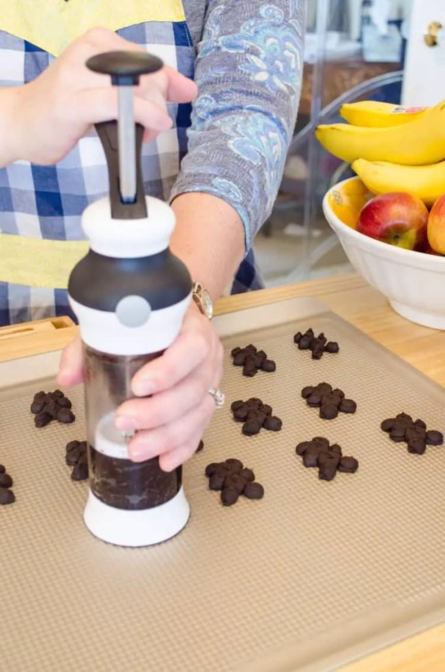 Using the OXO cookie press to make Chocolate Cinnamon Bear Cookies!