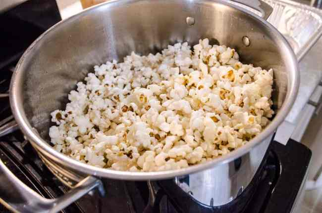 A stockpot full of popped popcorn for Microwave Caramel Popcorn - The Goldilocks Kitchen