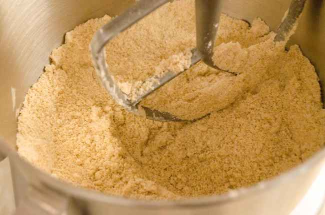 Butter and flour are beaten together to form a sandy looking mixture for Easy Gingerbread Cookies - The Goldilocks Kitchen