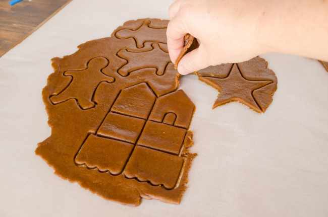 Excess Easy Gingerbread Cookies dough is peeled away from the cookie cutter shapes - The Goldilocks Kitchen