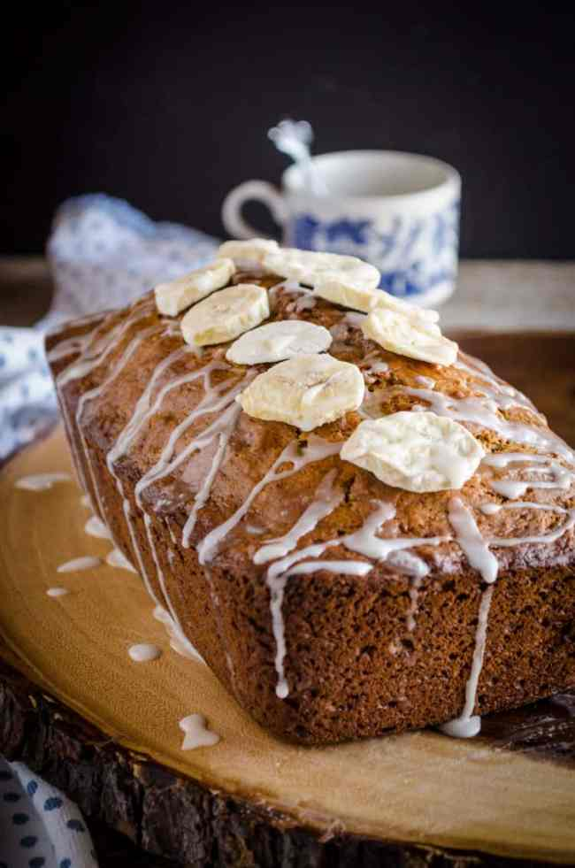 Orange Spice Banana Bread topped with orange glaze and banana chips - The Goldilocks Kitchen