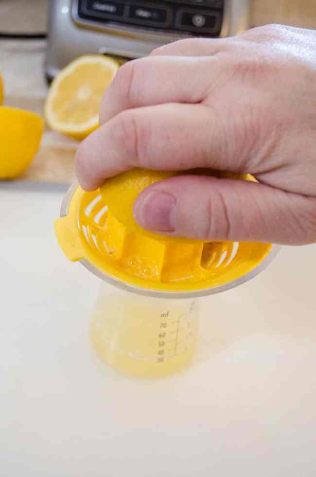 Juicing a sliced lemon to make a Lemonade Sparkler - The Goldilocks Kitchen