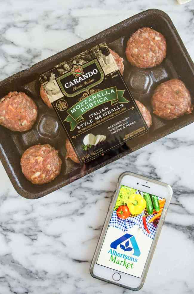 Carando brand Mozzarella Rustica Italian Style Meatballs in their packaging next to a phone with the Albertson's logo. - The Goldilocks Kitchen