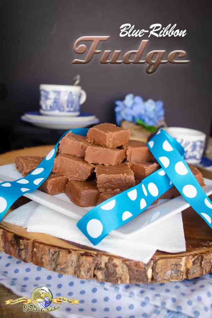 Looking for a no-stress award-winning chocolate fudge recipe? Blue-Ribbon Fudge from The Goldilocks Kitchen is the recipe you need. It doesn't require a candy thermometer and is very versatile, allowing you to create multiple flavors. This recipe makes a 5-pound batch- perfect for sharing with friends and family for special occasions. Check it out now. #chocolatefudge #fudge #chocolatelover #holidaytreats #awardwinning #blueribbon