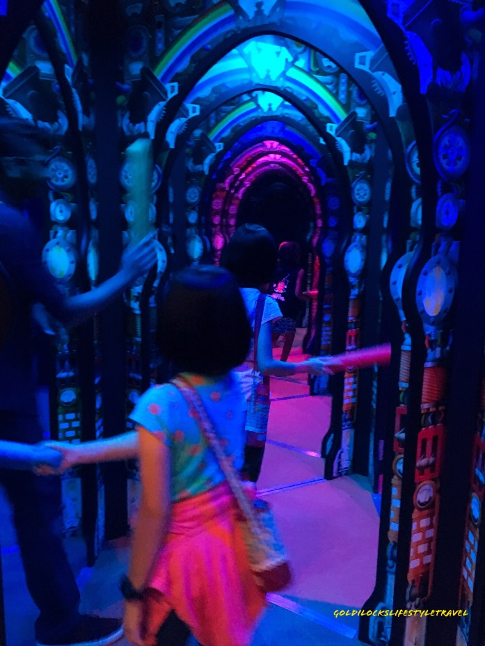 Using the noddles to navigate inside the mirror maze (Inside the Professor Crackitts Light Fantastic Mirror Maze in Science Center Singapore)