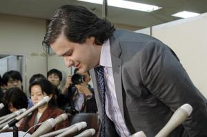 Disgraced Mt. Gox CEO, Mark Karpeles, bows before declaring bankruptcy.