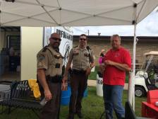 Oronoco Gold Rush Volunteers assist the deputies with information.