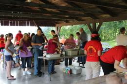 Oronoco Gold Rush Volunteers help cook and serve the food.