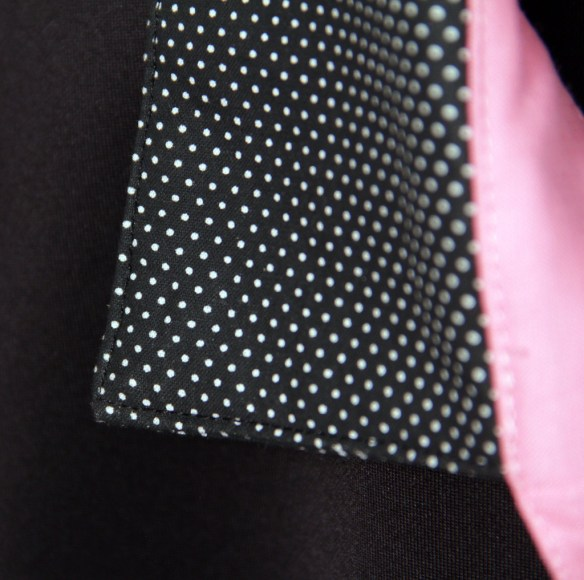 Polka dot detailing on the collar.