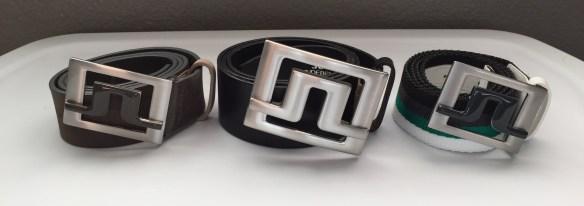 Original J.Lindeberg Slater belt (center) with large buckle and wide strap. New Slater 40 2.0 belts (left and right) with smaller buckle and thinner strap.