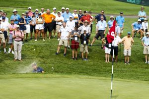 Nick Carlson hits out of a bunker on the ninth hole during third round of match play at the 2016 U.S. Amateur at Oakland Hills Country Club  in Bloomfield Hills, Mich. on Thursday, Aug. 18, 2016. (Copyright USGA/Jeff Haynes)