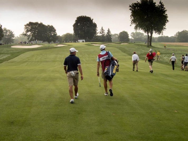 Nick Carlson walks up to the second green.