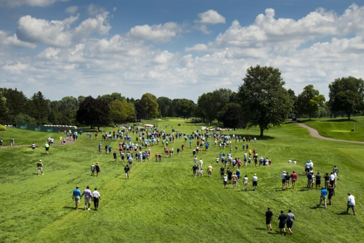 Fans walk down the first fairway with the first match during the quarterfinal round of match play at the 2016 U.S. Amateur at Oakland Hills Country Club in Bloomfield Hills, Mich. on Friday, Aug. 19, 2016. (Copyright USGA/John Mummert)