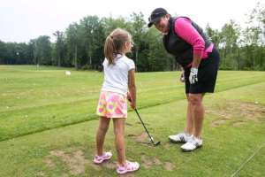 Meg Mallon teaches at a junior golf clinic at the Tullymore Classic in Michigan. Photo by Andrew Knapik.