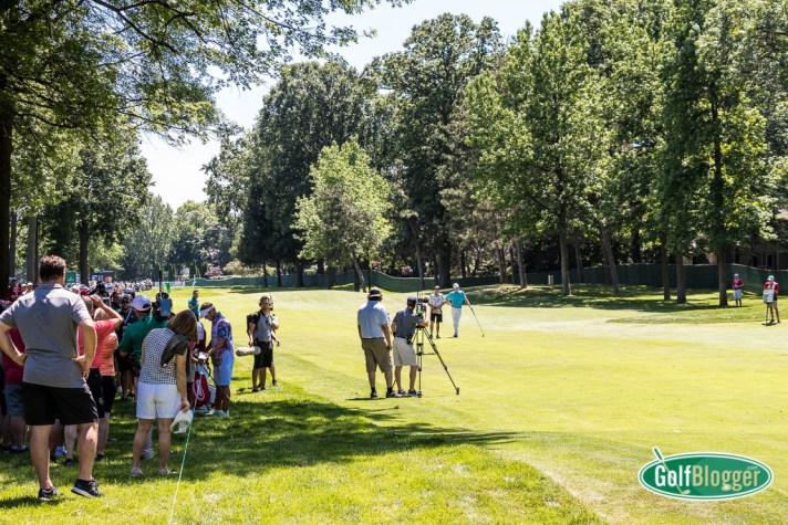 Fans watch from the shade as Brandt Snedeker prepares for a shot on the tree-lined seventh at the Rocket Mortgage Classic.