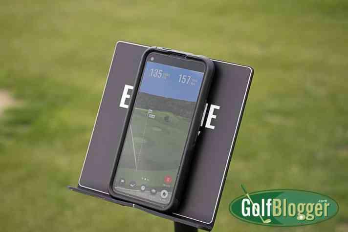 Trackman Comes To Boyne Golf In Northern Michigan -- Trackman on phone