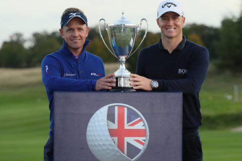 Tournament host Luke Donald of and Champion Alex Noren of Sweden pose with the trophy following the fourth round of the British Masters at The Grove on October 16, 2016 in Watford, England.
