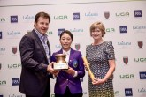 Sir Nick Faldo and The R&A's Alison White presenting Hung Jo-hua with her prize as overall girls champion at the 11th Faldo Series Asia Grand Final.
