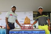 Professionals Chikkarangappa (left) and Rahil Gangjee (right) pose with the Golconda Masters trophy