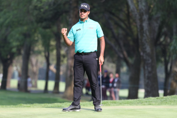 The young man is taking the envelope and shredding it into pieces. Shubhankar produced an incredible back nine effort to claim a two-stroke lead