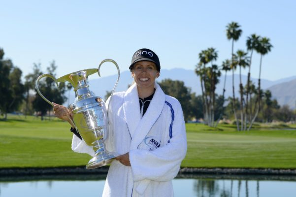 Pernilla Lindberg of Sweden poses with the winner's trophy after defeating Inbe Park of South Korea during the sudden death playoff on the eighth hole during the final round of the ANA Inspiration on the Dinah Shore Tournament Course at Mission Hills Country Club on April 2, 2018 in Rancho Mirage, California. Play resumed today after play was suspended due to darkness yesterday. (Photo by Robert Laberge/Getty Images)